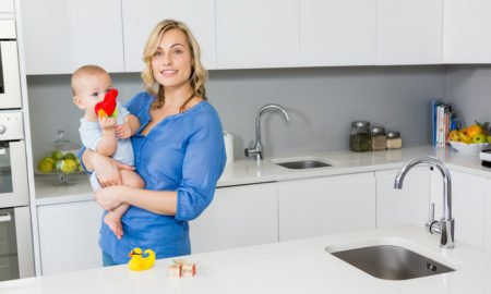 Mother with a baby at Kitchen