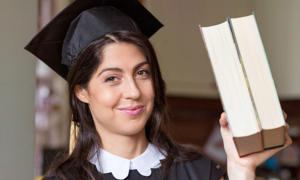 graduated girl with two books