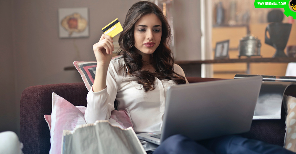 A woman using credit card for online payment