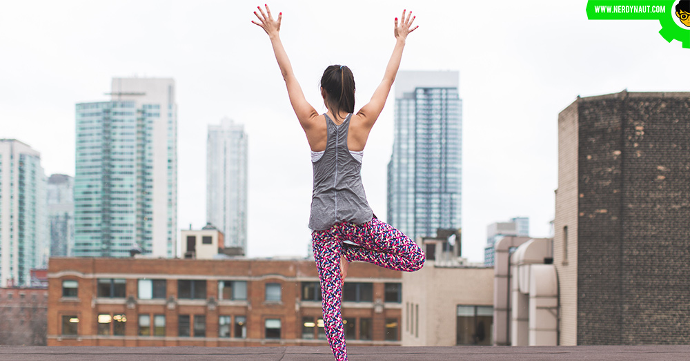 Woman doing yoga on a roof top