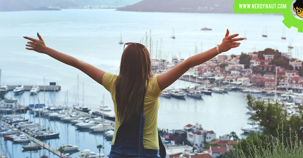 Woman Raising Her Hands Facing Cityscape Near Body of Water - New Zealand
