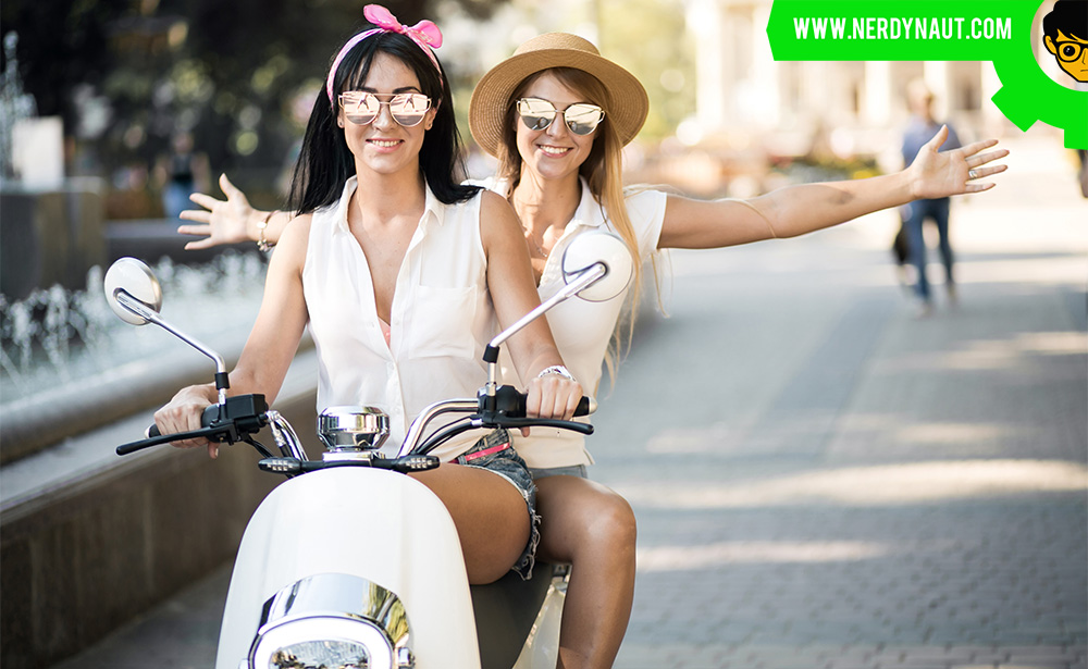 two women Learning How to Ride a Motorcycle