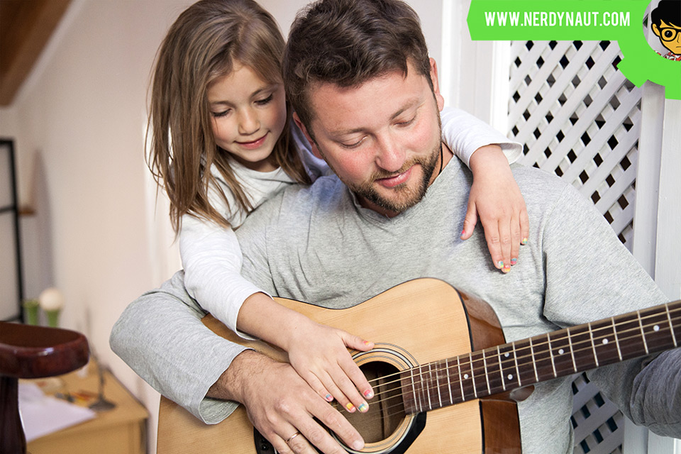 7 Tips For Engaging Students In Music Lessons - Father and daughter playing a guitar