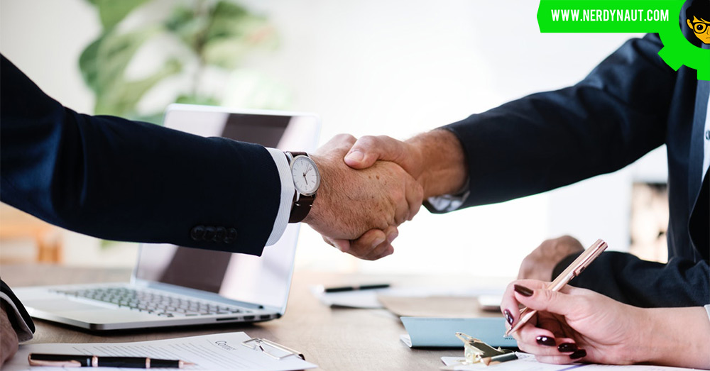 How to Make an Impression on Potential Clients - Handshake two men