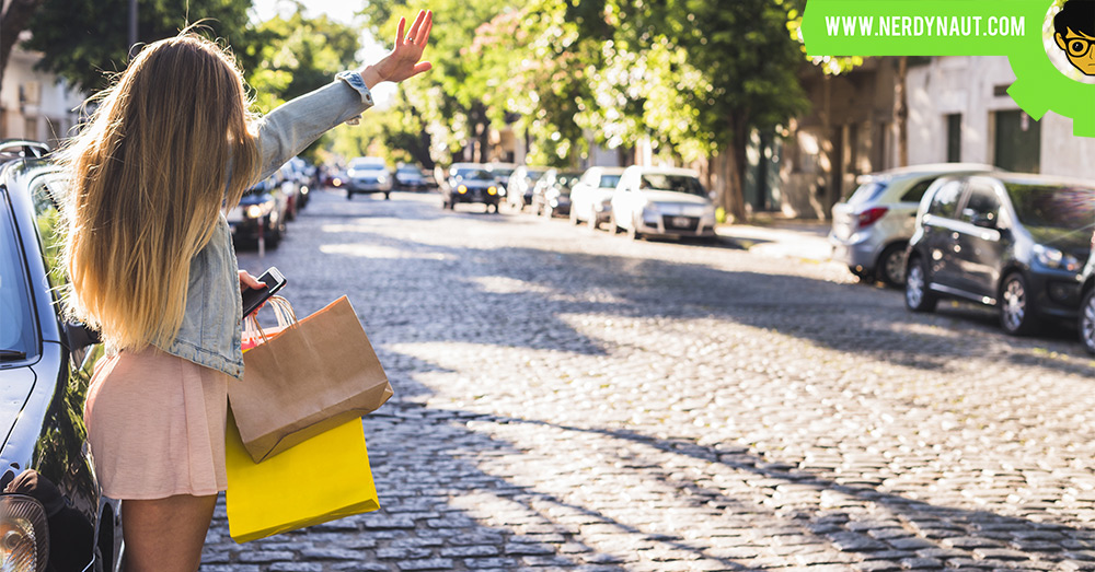 A woman waving hand for a taxi