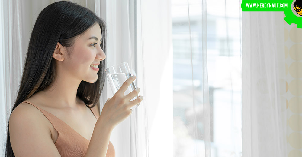 Asian girl drinking purified water