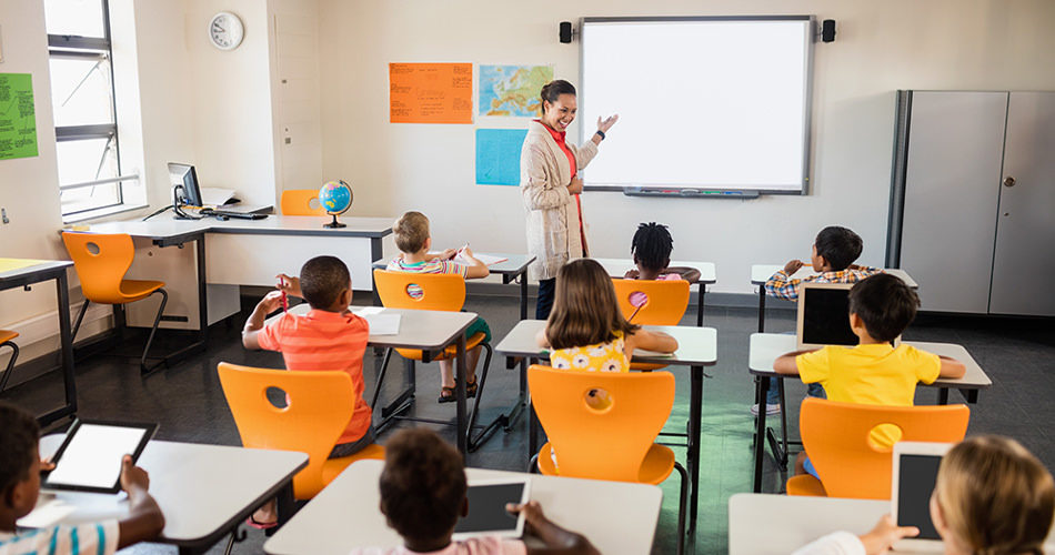 School kids and teacher in class