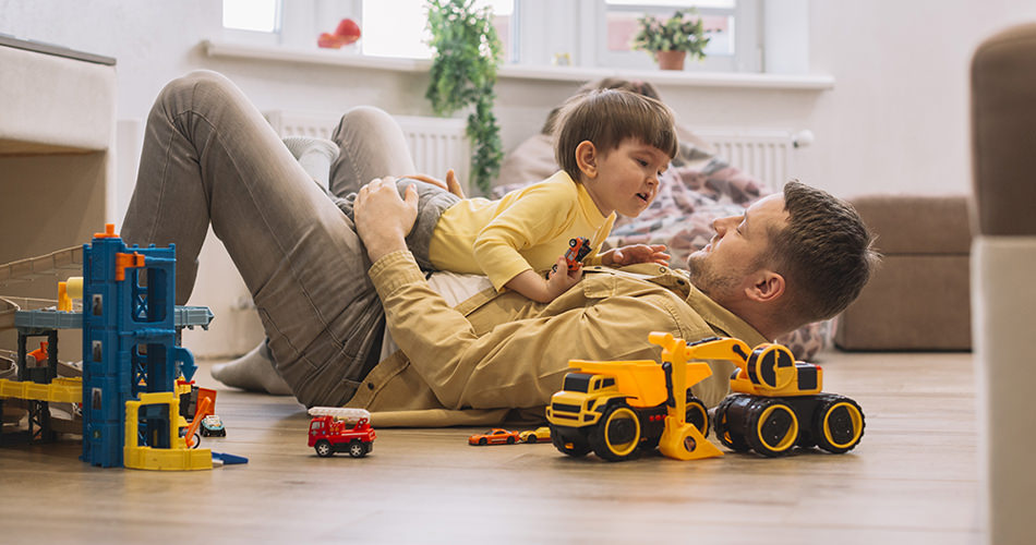 Dad playing with a son on the floor