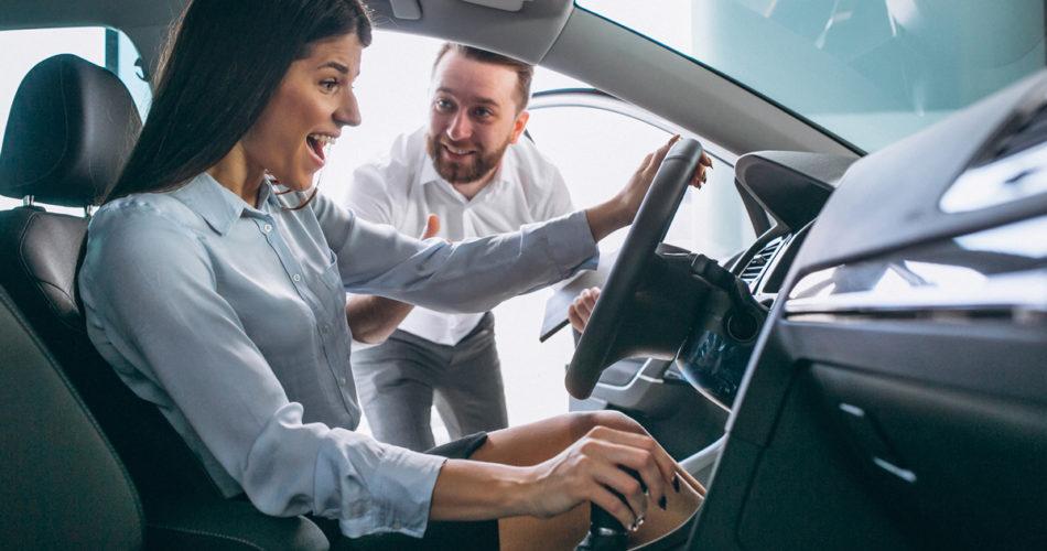 Car salesman showing a car to woman