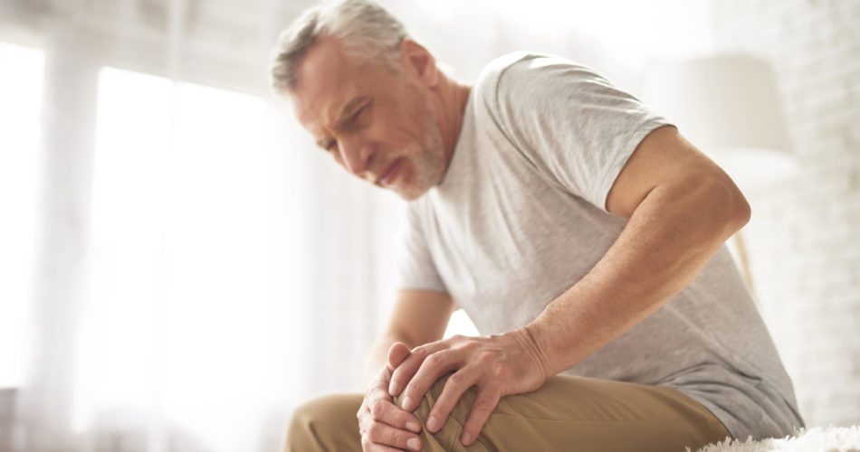 an elderly man with arthritis